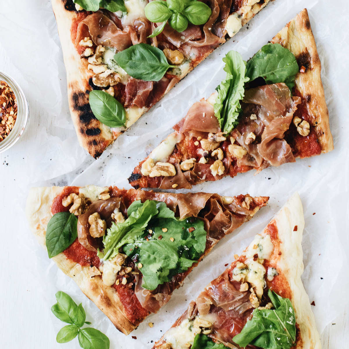 Grilled Pizza with Prosciutto, Blue Cheese, Walnuts, and Arugula