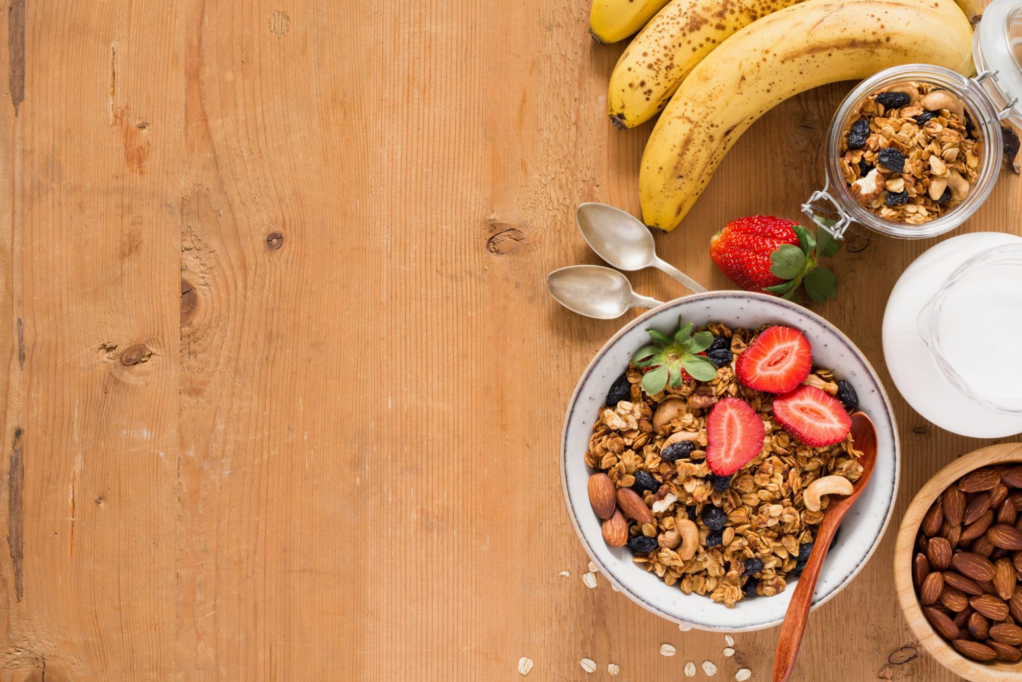Granola, fruits and milk for healthy breakfast