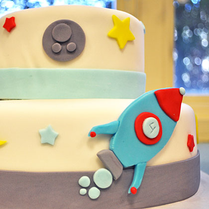 Keep the cake simple by using a white icing decorated with stars, planets, and a rocket ship. Serve the cake toward the end of the party so that you can enjoy it as a centerpiece on your table.
