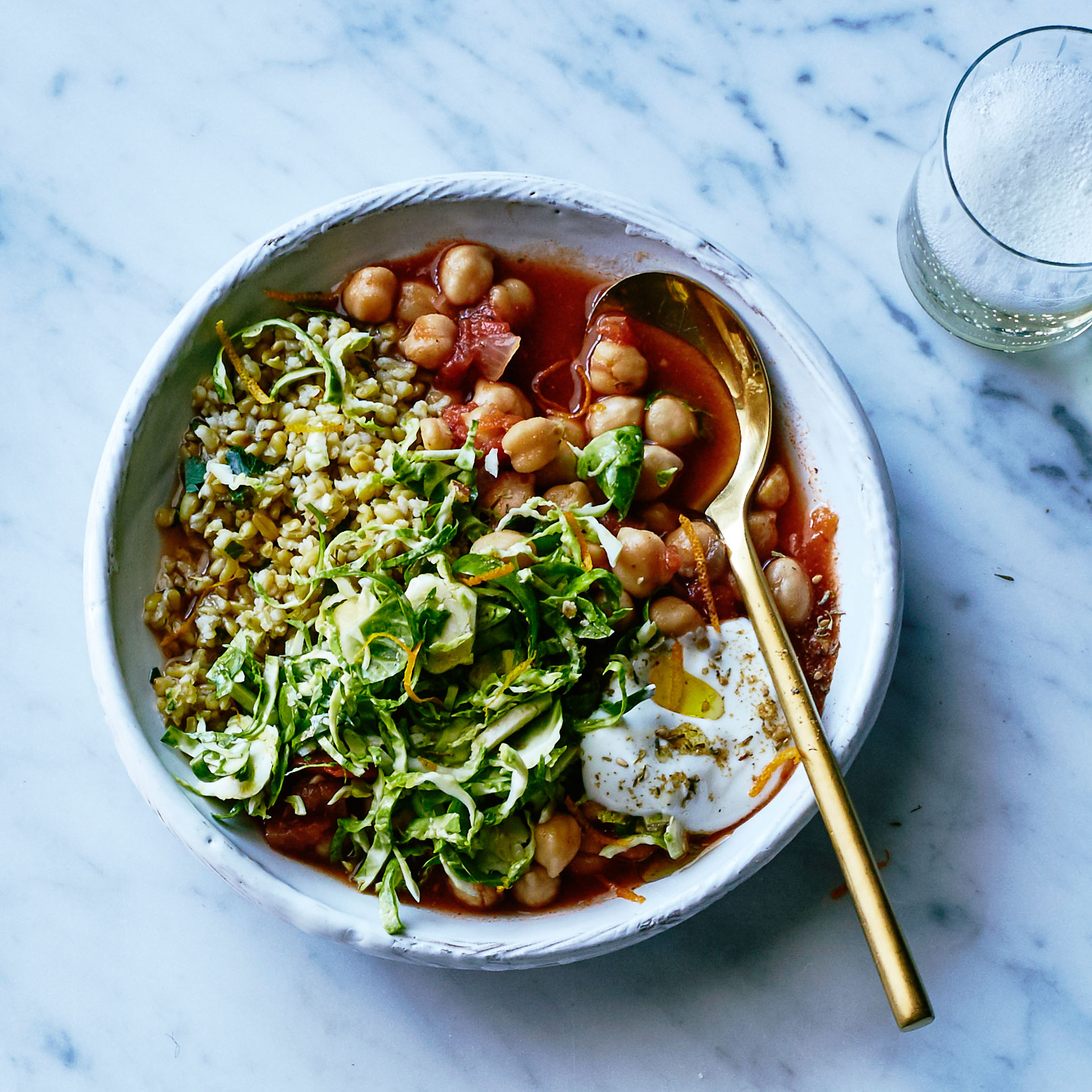 Saffron Tomato Chickpeas with Spiced Freekeh and Shaved Brussels Sprouts