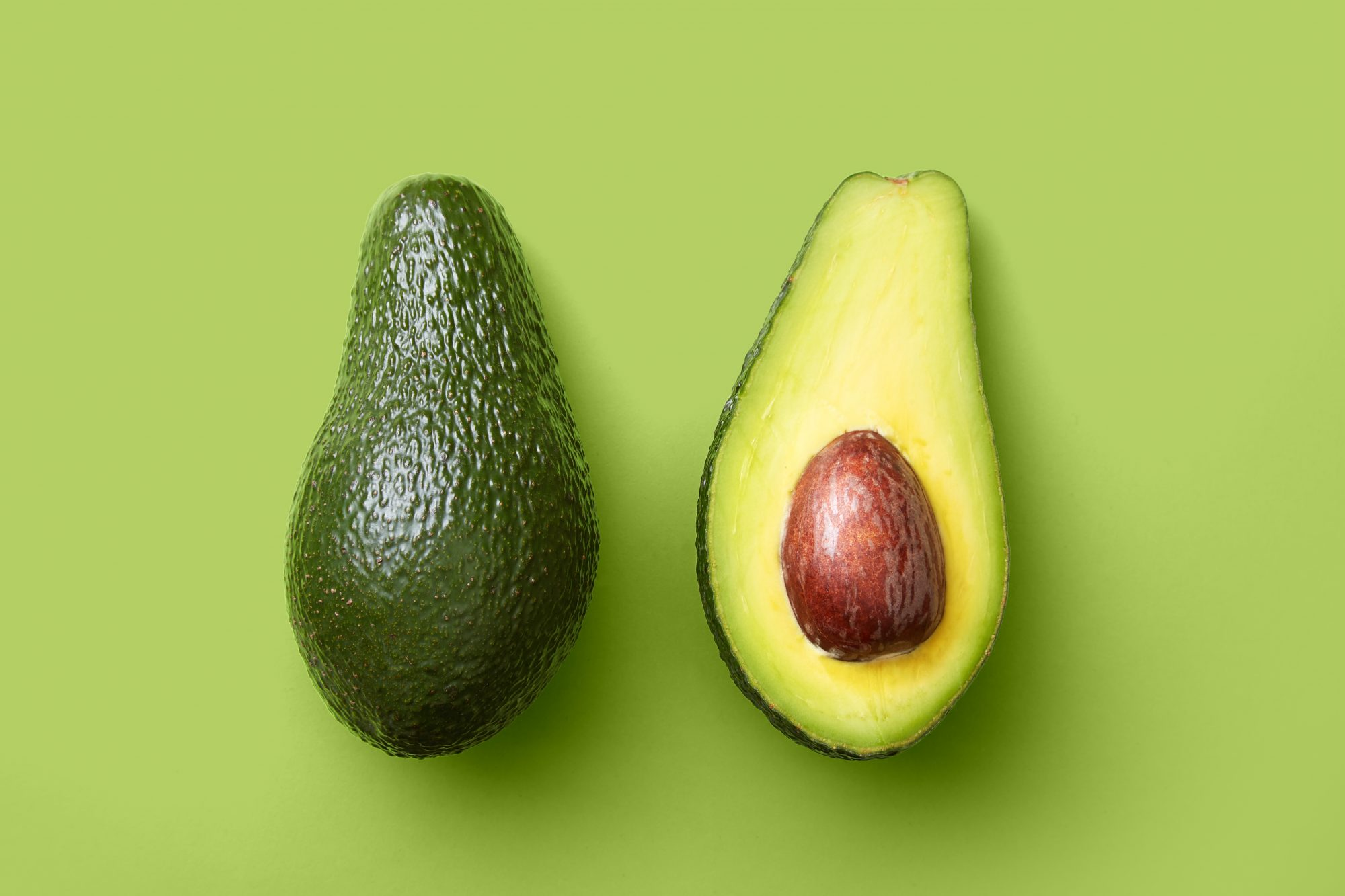 Avocados on green background Getty 4/27/20