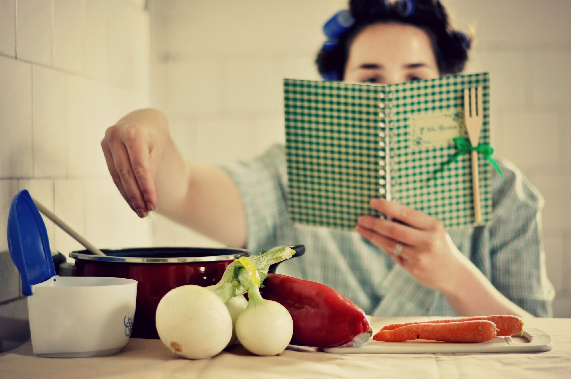 061520_Getty Retro Woman with Cookbook