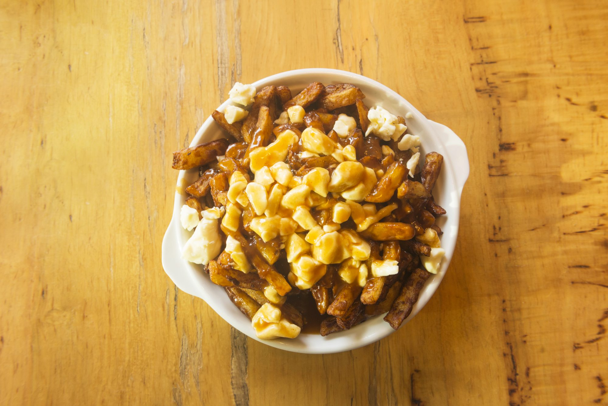 Poutine on wood 7/14/20 Getty