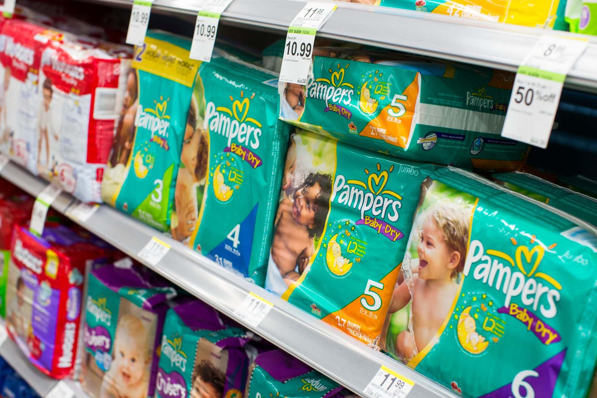 Pampers diapers on display at a store.