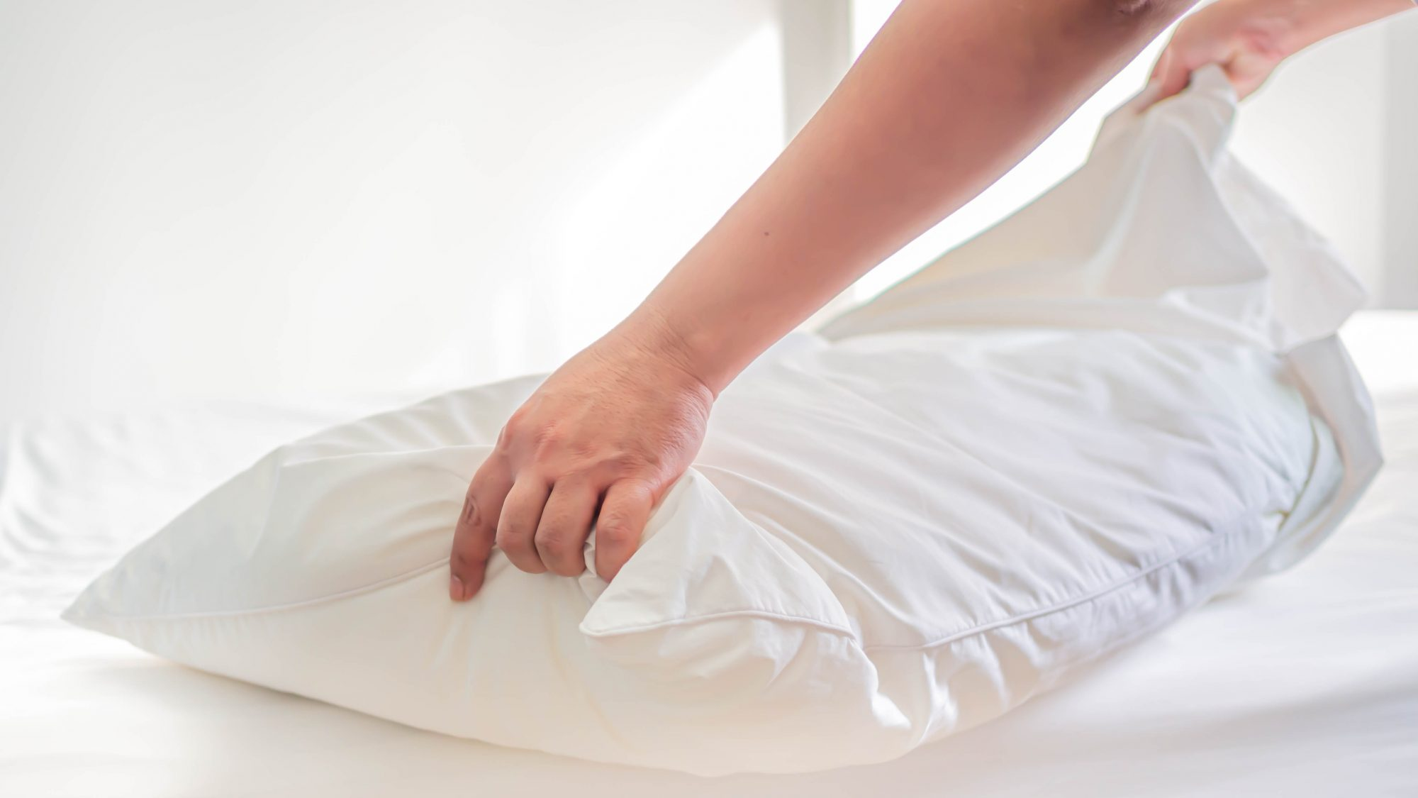 Putting on clean pillowcase