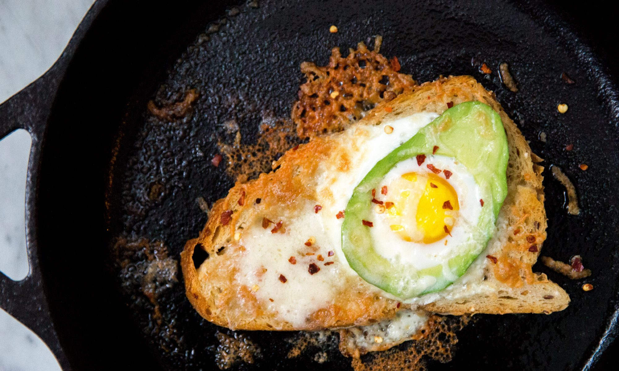 Avocado Egg-in-a-Hole Is the Breakfast Frankensandwich You Deserve