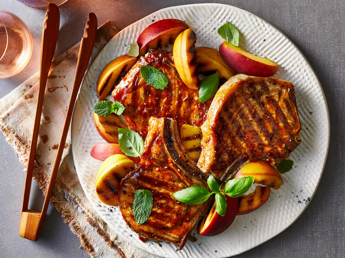 Grilled Pork Chops and Peaches with Sweet Chile Sauce image
