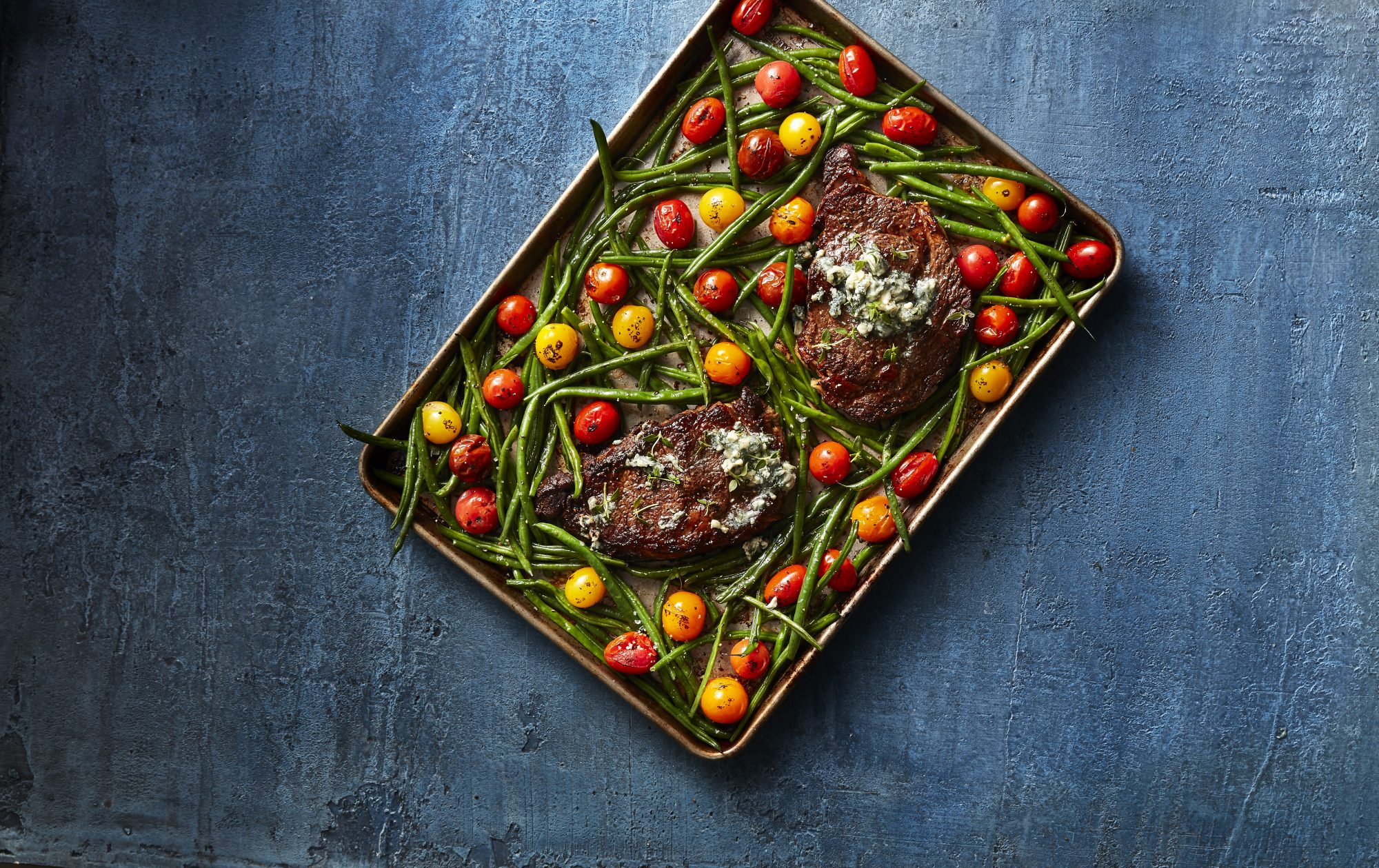 Rib-eyes with Veggies and Blue Cheese Butter image