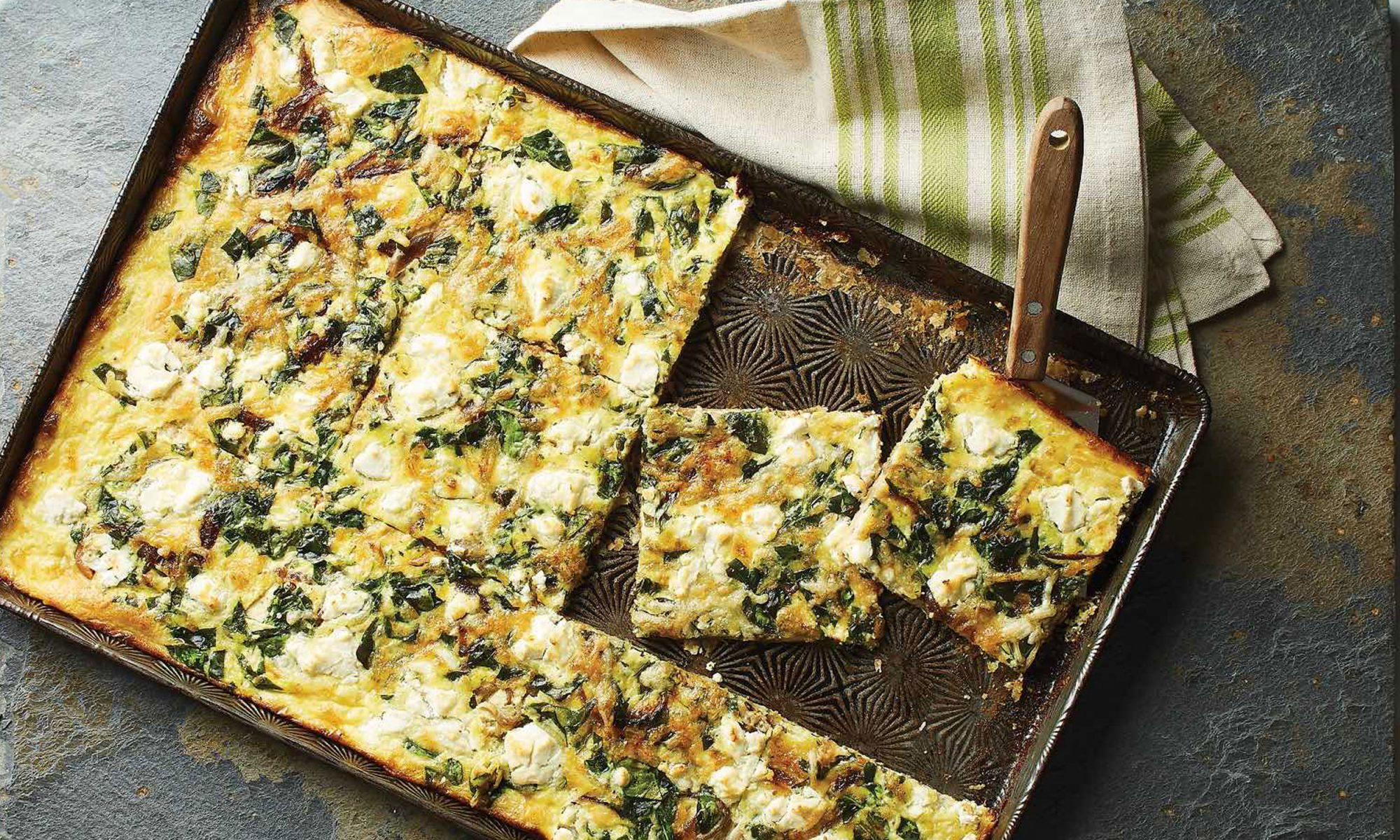 Slab Quiche with Spinach, Goat Cheese, and Caramelized Onions