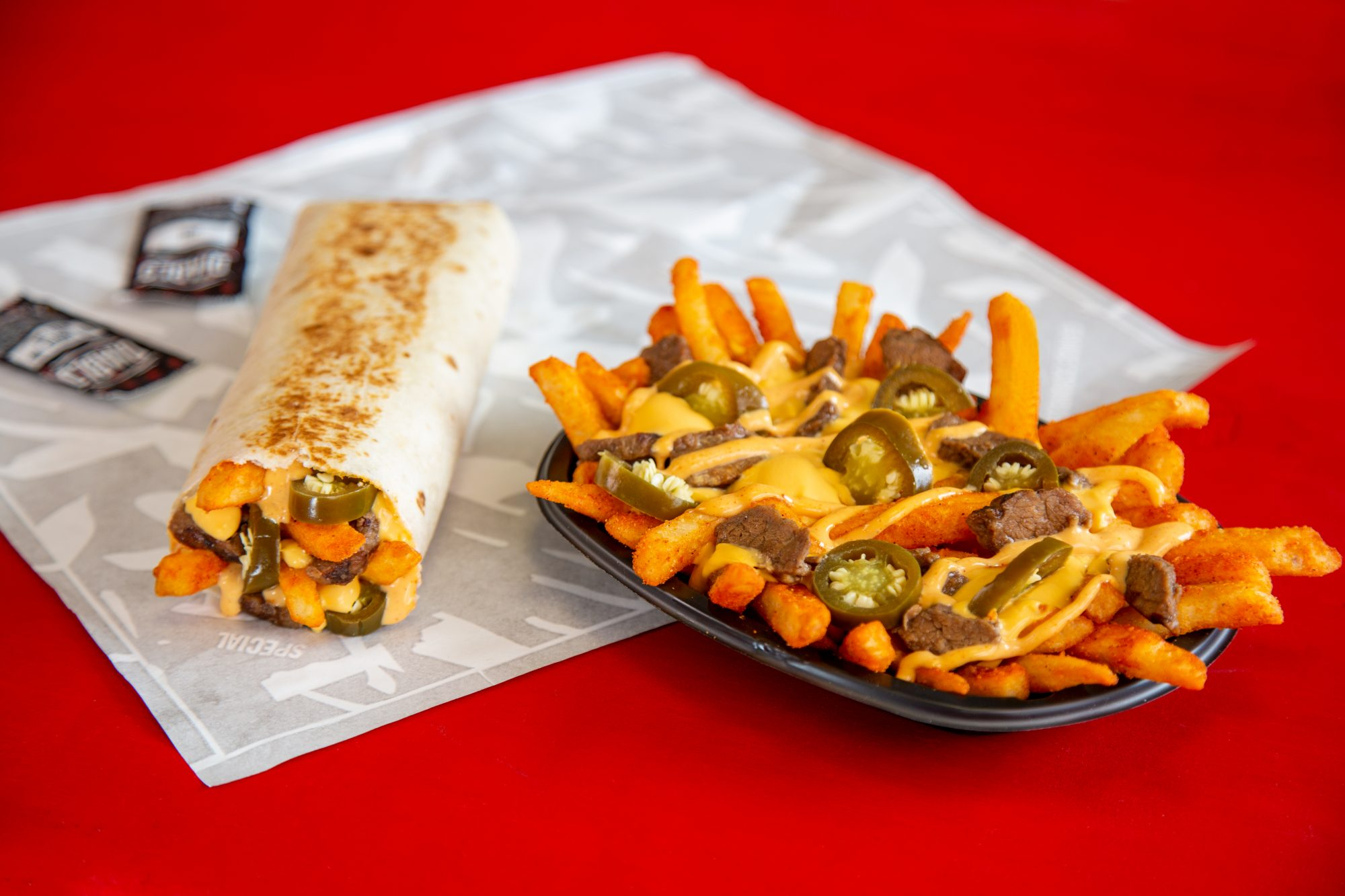 Taco Bell's New Steak Rattlesnake Fries Look Deliciously Spicy