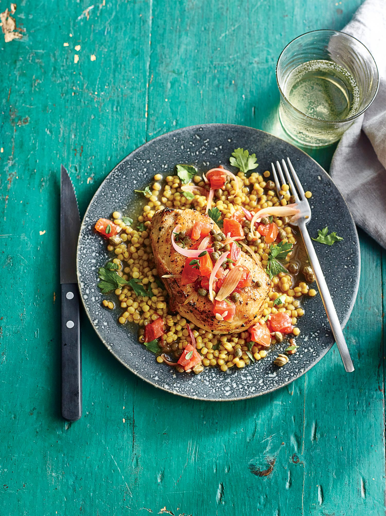 Pork Chops and Couscous with Tomato-Caper Sauce