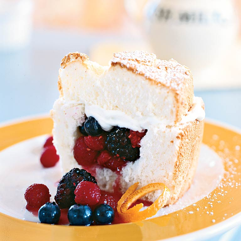 Angel Food Cake Stuffed with Whipped Cream and Berries