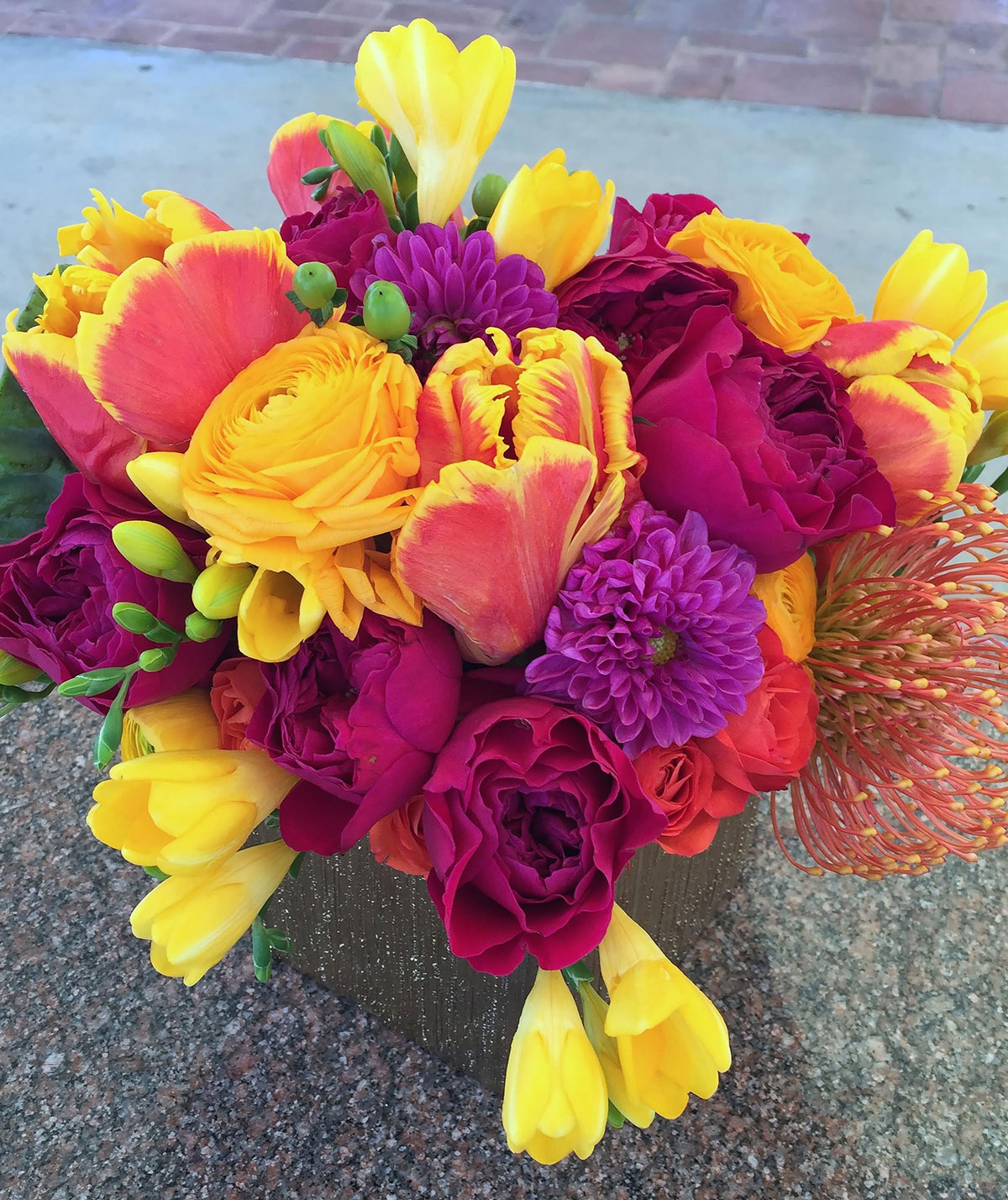 Bright-colored floral arrangement with parrot tulips
