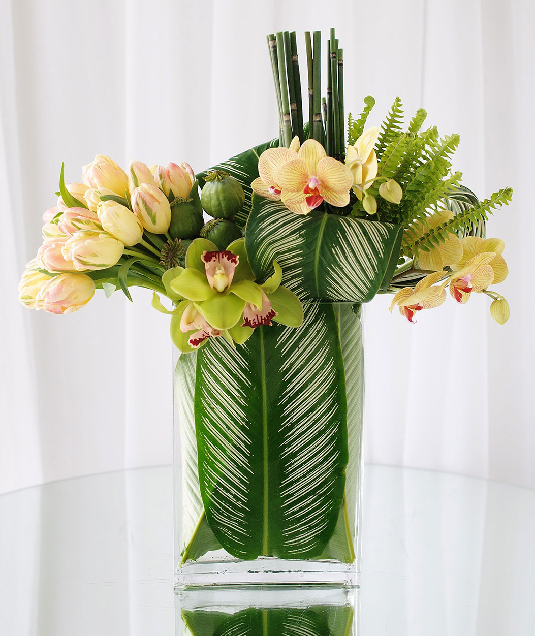 Yellow tulip and orchid arrangement