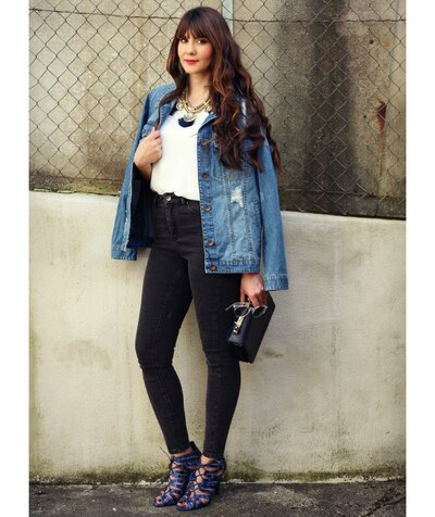 0ed4614e712 Woman wearing hip-length denim jacket with black jeans and cage heels