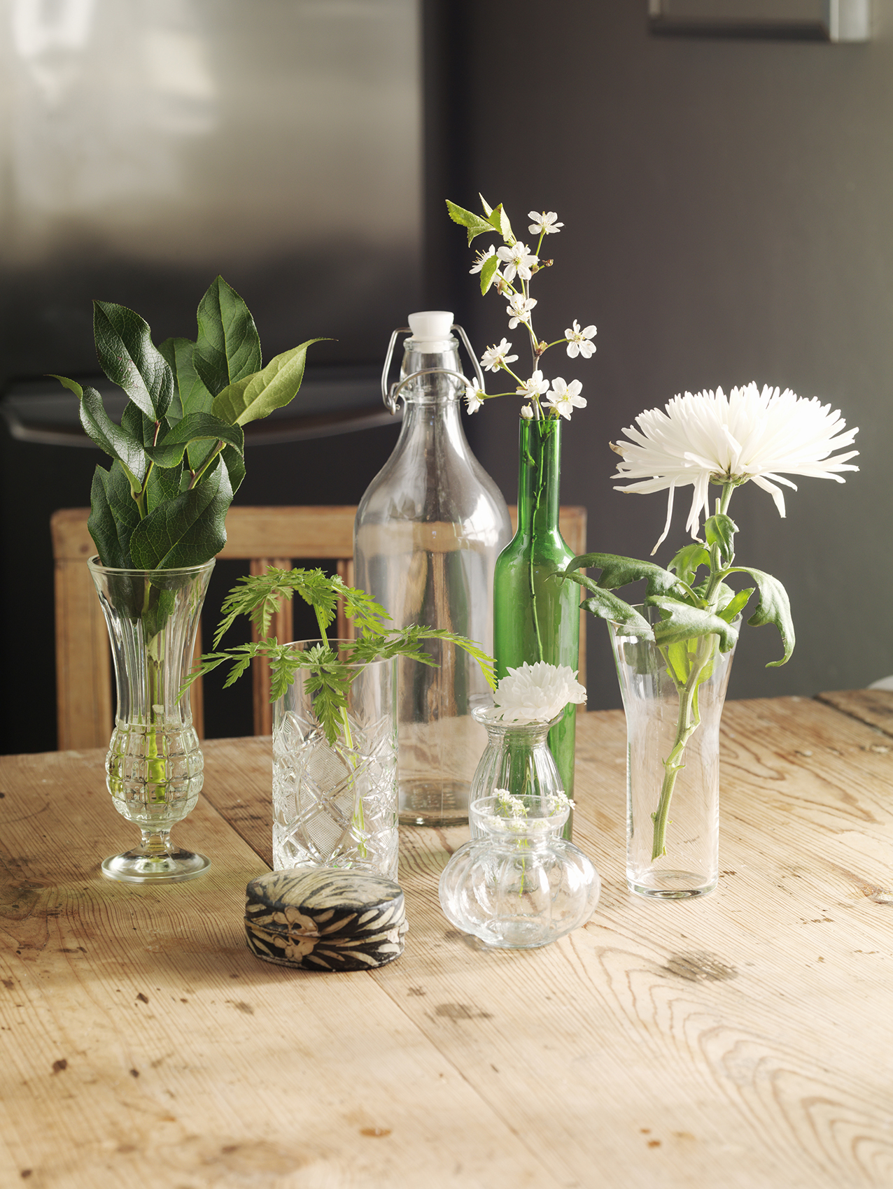 Flowers and clear vases on table