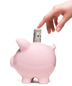 One hundred dollars and pink piggy bank