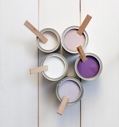 Paint cans in various hues