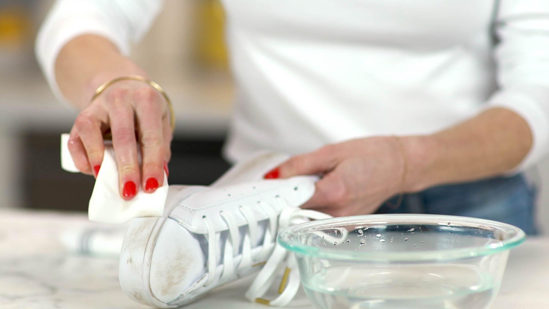 Cleaning a pair of white leather sneakers