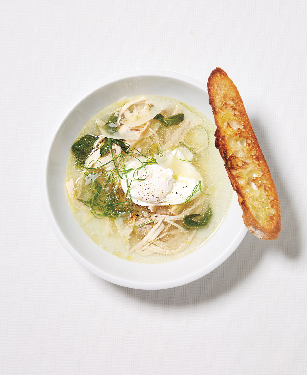Garlic and Chicken Soup With Poached Eggs