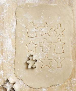 Christmas cookie dough with cut-out shapes