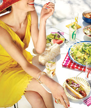 Woman in a yellow dress at a picnic