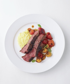 Steak With Roasted Peppers and Tomatoes Over Polenta