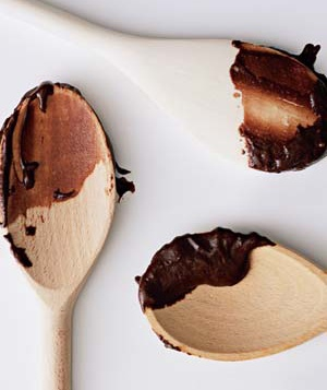 Chocolate batter on wooden spoons
