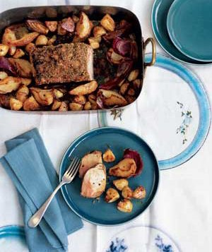 Fennel-crusted pok loin with roasted potatoes and pears