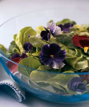 Glass bowl of leaves and flowers