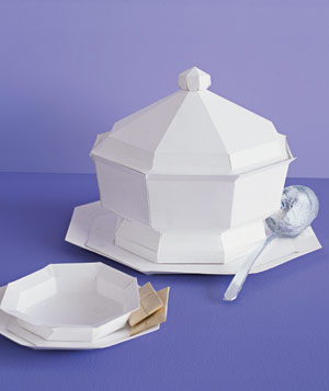 Paper construction of soup pot and bowl with spoon and crackers by Matthew Sporzynski