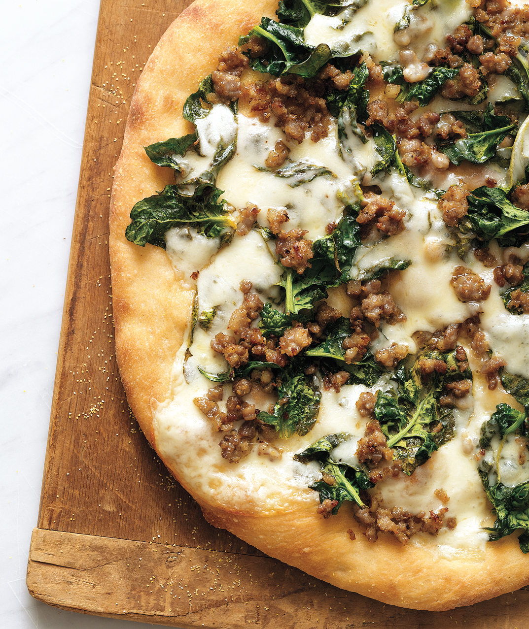 Sausage, Spinach, and Provolone Pizza