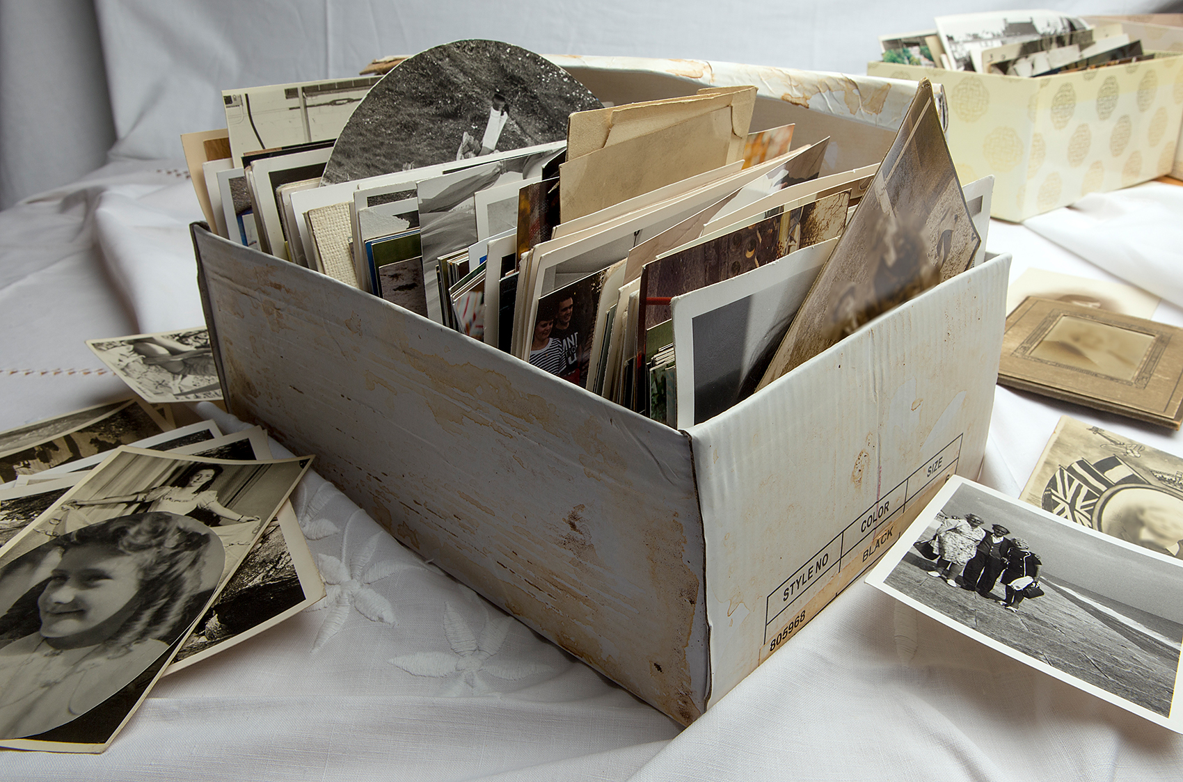 Decluttering solutions photos in old box