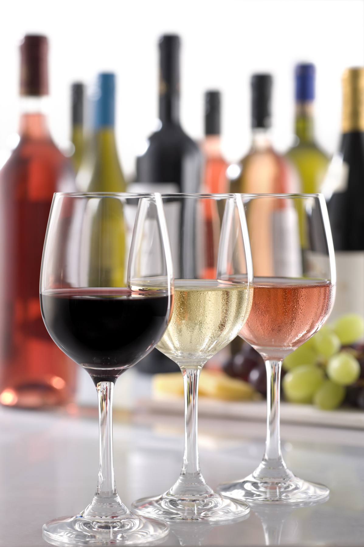 Glasses of red, white and rosé wines at bar