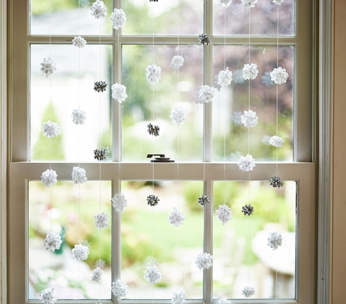 Christmas decoration ideas, Silver and white gift bows hanging in window