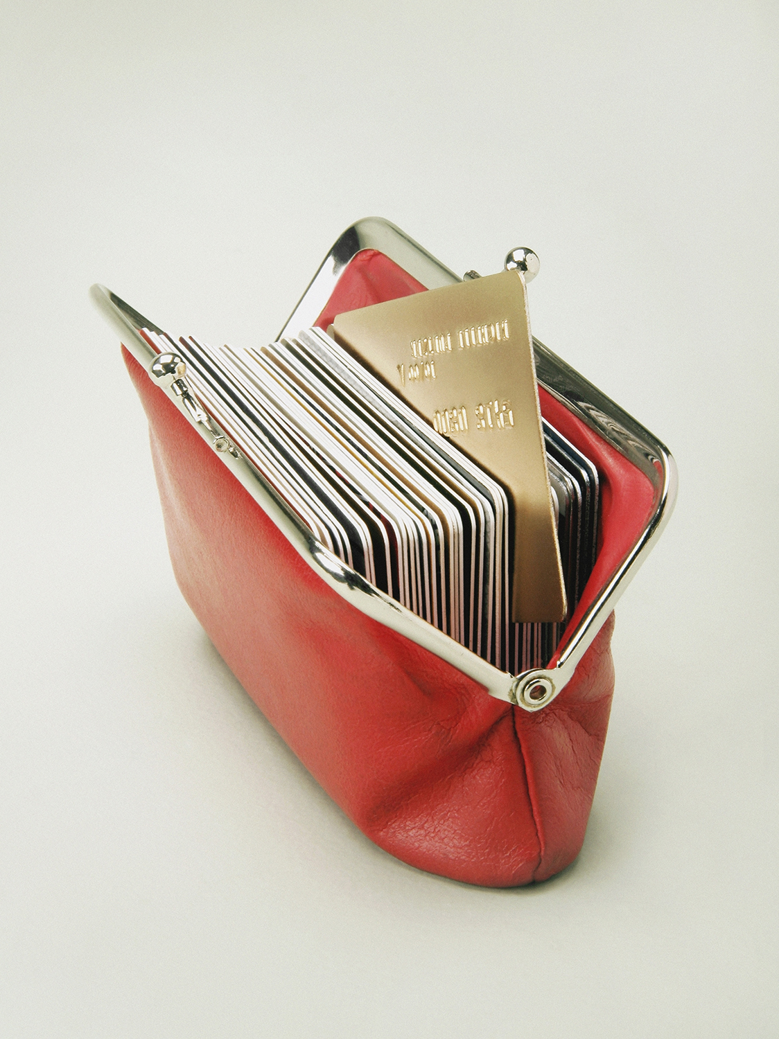 Red wallet full of credit cards