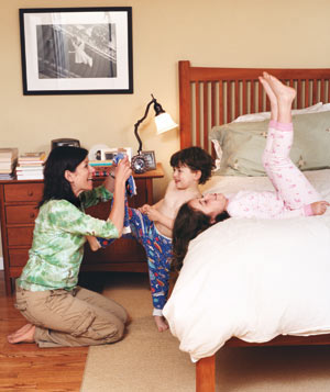 Mom getting her son and daughter ready for bed