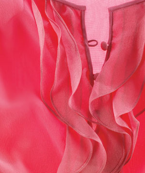 Ruffles on a pink blouse