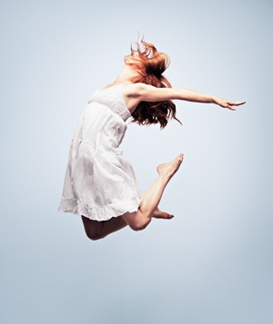 Woman jumping and stretching