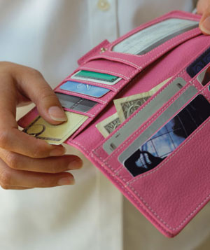 Hands holding woman's wallet