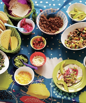 Taco bar with toppings and sides