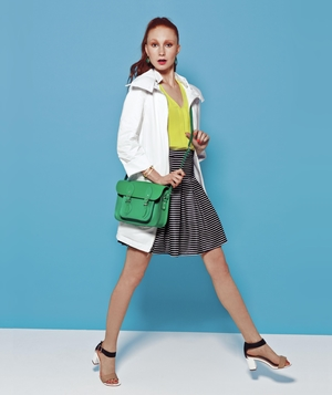 Spring outfit with white jacket, yellow top, and skirt