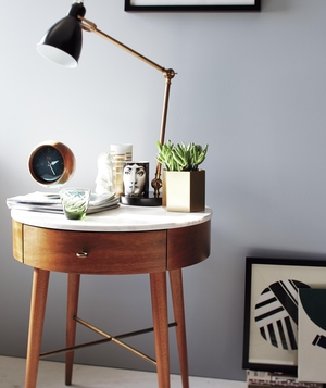 Bedside table with lamp and other decor