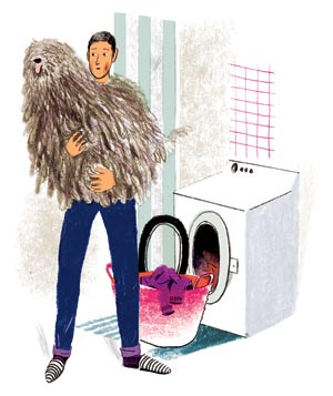 Man pulling dog out of dryer