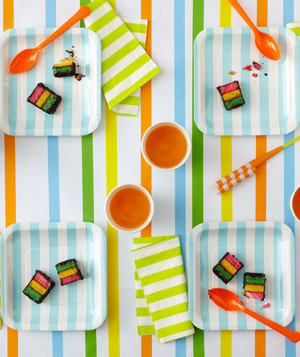 Striped table cloth and paper goods for a birthday party