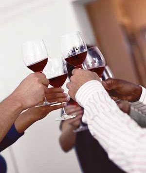Friends toasting one another