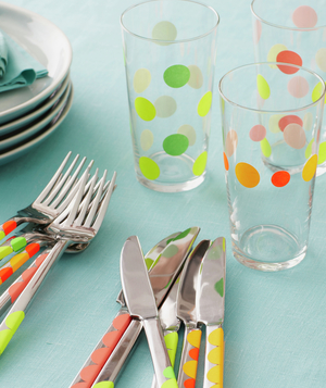Flatware and drinking glasses decorated with sticky dots