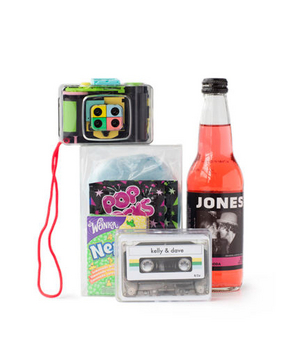 Pop rocks, nerds candy, a cassette tape, and a disposable camera