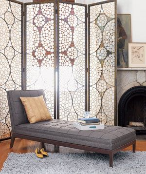Lounge in front of a decorative screen