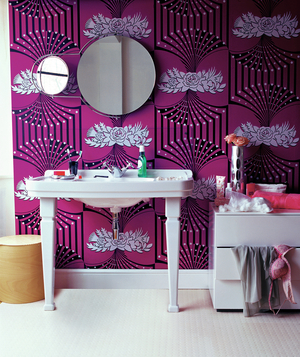 Bathroom with freestanding sink and magenta patterned wallpaper
